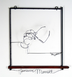 Figurative wire sculpture of hand holding eyeglasses